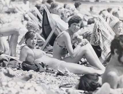Young women sunbathing on Eastbourne beach, July 1976.