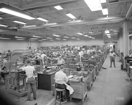 'Machine shop men working at machines', 1946.