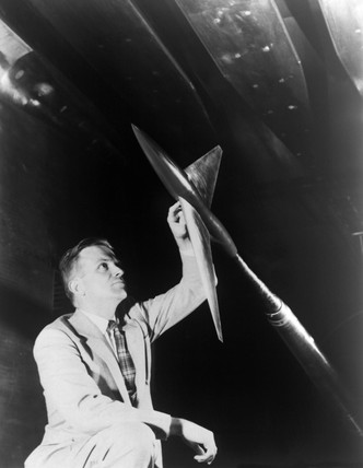 Richard Whitcomb Examines Model, Langley Research Center, 1955.