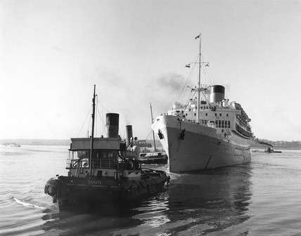 'Oranje' steam ship with tugboat, Ocean Dock, Southampton, 1950.