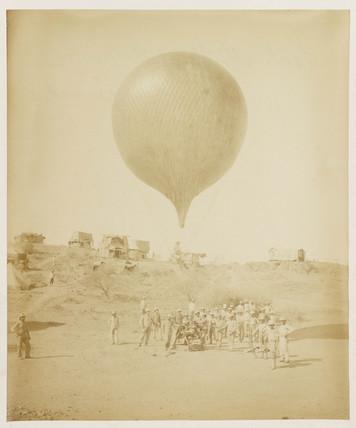 A balloon in a desert setting, 1885-1890.