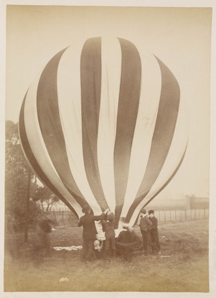 A balloon being inflated, 1885-1890.