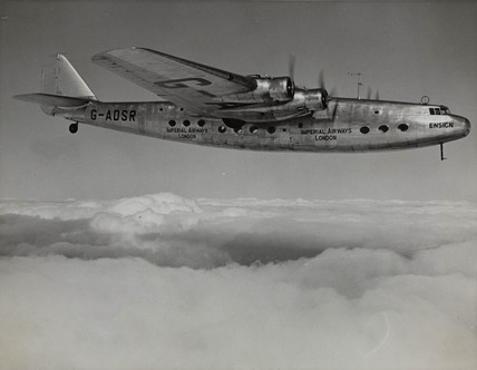 Ensign prototype G-ADSR in flight above the clouds, c 1930s.