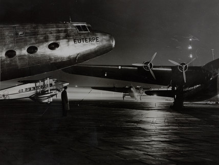 Three Ensigns under the Croydon Airport floodlights, 1938.