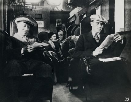 Pasengers reading during an airliner flight, c 1940s.