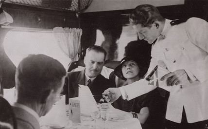 Steward serving lunch in the cabin of an Imperial Airways Scylla, 1934.