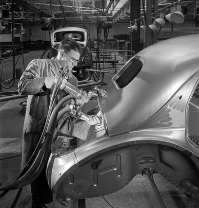 Rivetting a car body, Brixton, 1951.