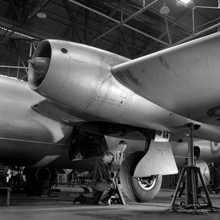 An apprentice trains on undercarriage of Canberra 8 aircraft , Preston, 1956.