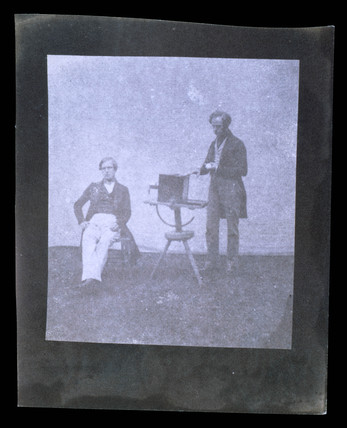 Men with camera, 19th century.