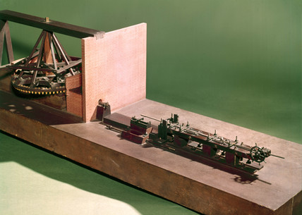 Model gun-boring machine.