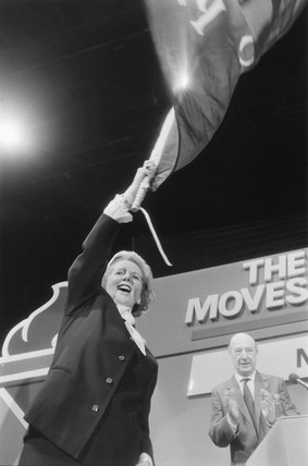 Margaret Thatcher waving a flag during the election campaign, 10 June 1987.