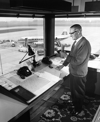 Apron control at Manchester Airport, controller with microphone, 1965.