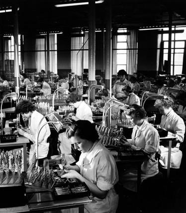 Mullard female employees asemble cathode ray guns at Simonstone, 1956.