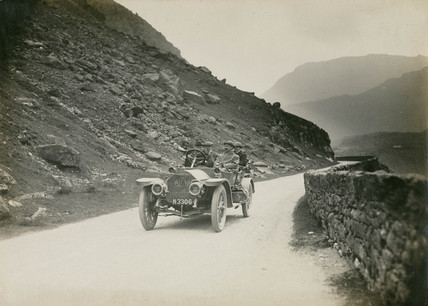 Motor car crosing Nant Francon Pas, Wales, c 1912.