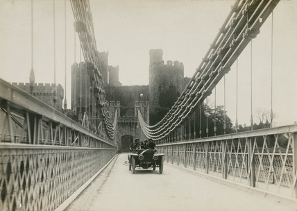 Motor car crosing a suspension bridge, Conwy, Wales, c 1912.