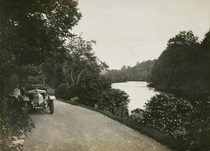 Motor car beside the River Dee, Wales, c 1912.