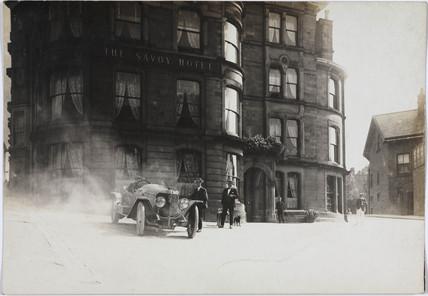 Motor car outside a hotel, c 1912.