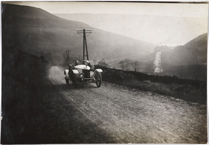 Motor car on a country road, c 1912.