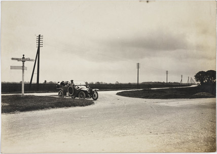 Motor car at a crosroads, Prees Heath, Shropshire, c 1912.