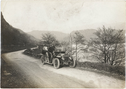 Motor car beside a lake, Wales, c 1912.