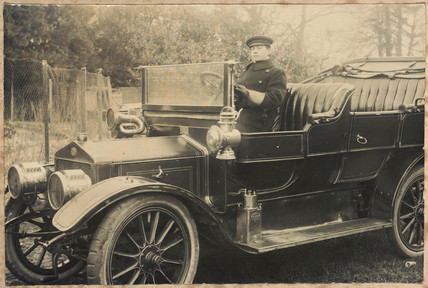 Chauffeur at the wheel of a motor car, c 1905-1920.