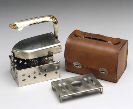 Travelling iron, c 1900.