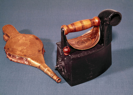 Cannon charcoal heated flat-iron and bellows, c 1850.