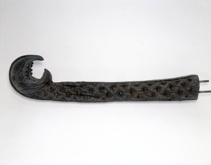 Plaster cast of head or stern ornament of Viking ship.