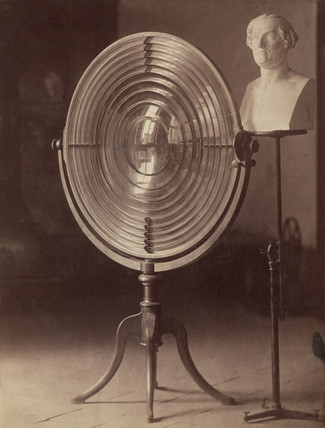 Fresnel lens used by Melloni and a bust of Melloni, 1876.