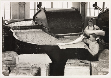 Beater filling (men adding pulp), 1936.