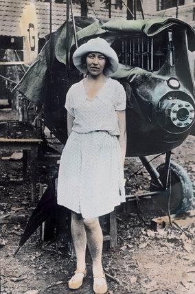 Amy Johnson at Rangoon with damaged plane, Burma (Myanmar), 3 June 1930.