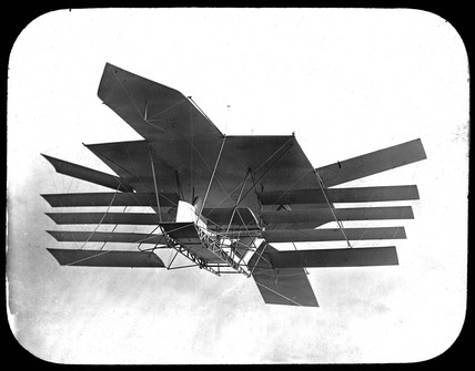An impression of a Maxim multiplaned flying machine in flight, 1890s.