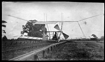 Maxim's flying machine on its launch track, seen from behind, 1894.