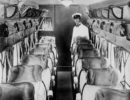 Steward standing inside empty 'Argosy' passenger aeroplane, late 1920s.