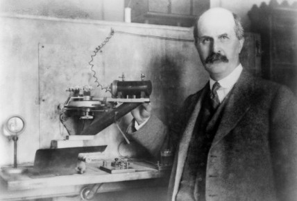 William Henry Bragg, English physicist, with his spectrometer, c 1910s.