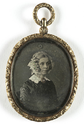 Portrait of a woman contained in a locket, mid-late 19th century.