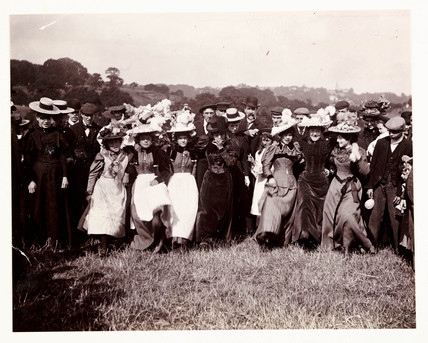 Line of dancing women, c 1898.