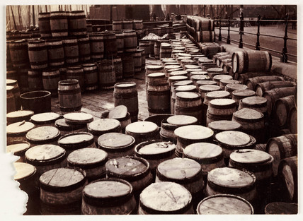 Barrels on a harbour-side, Whitby, c 1905.