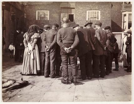 A fish auction, c 1905.