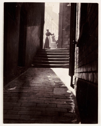 Shadows in an alleyway, c 1905.