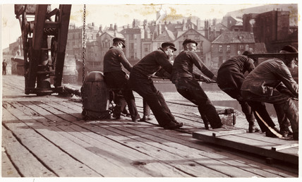 Men pulling a rope, c 1903.