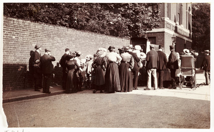 Crowd in a street, c 1905.