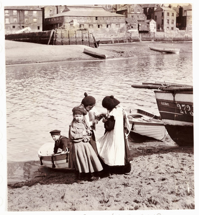 Children playing by the water's edge, Whitby Harbour, c 1905.