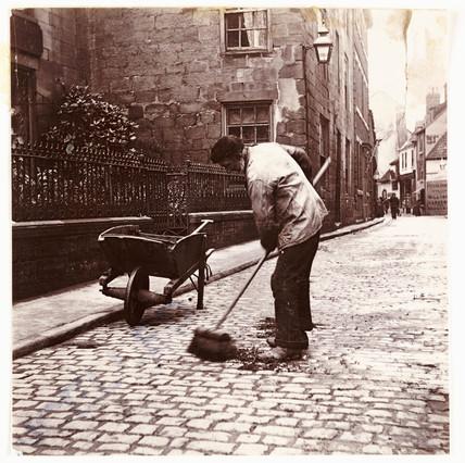 Street sweeper, c 1905.