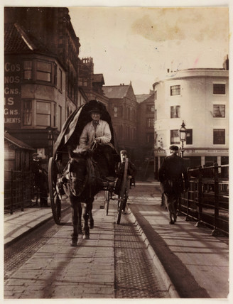 A man driving a horse and cart, Whitby, North Yorkshire, c 1905.