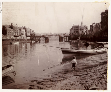 Small boy at the harbour edge, Whitby, North Yorkshire, c 1900.