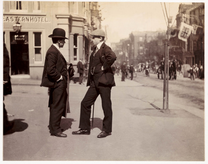 Two smartly dressed men in conversation, c 1900.