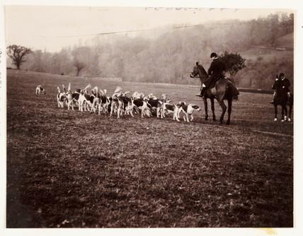 Huntsman and hounds, c 1905.