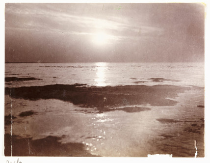 Low sun over a seashore, c 1905.