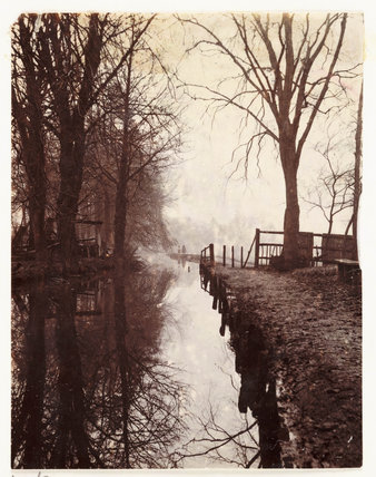 Tree-lined river, c 1898.